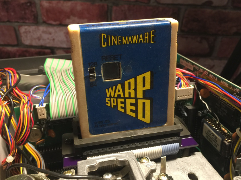 Warp Speed cartridge plugged into SX-64 new short expansion board PCB (shown without top case cover).