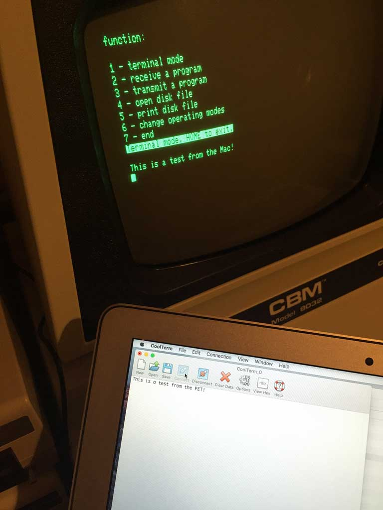 Commodore PET and MacBook Air communicating over a RS-232 serial connection.