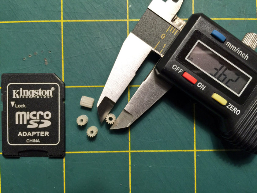 Commodore 1520 plotter X/Y gears in digital calipers, about 3.6mm wide.